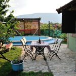 Holiday Home in Mostar Buna Little Paradise with open swimming pool - garden view with sitting by pool
